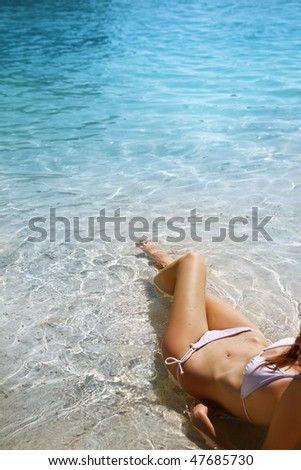 beautiful model relaxing on a beach - stock photo