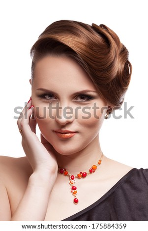 Beautiful model smiling on white background. Professional make up and artistic hairstyle. Studio shooting