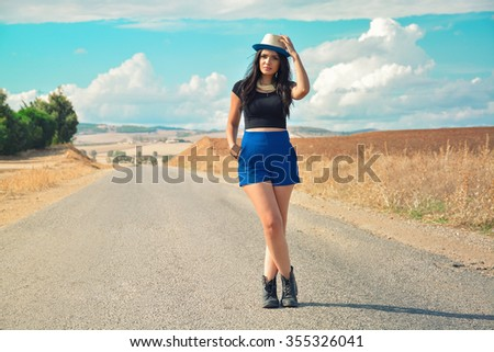 beautiful model Standing on the road  - stock photo