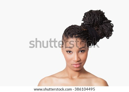 Beautiful model with braids smiling - stock photo