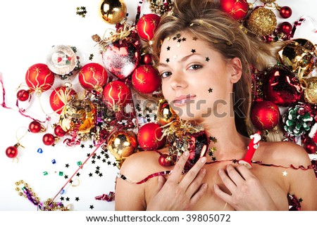 Beautiful model with Christmas decorations on white - stock photo