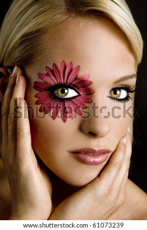 Beautiful model with dramatic flower makeup - stock photo