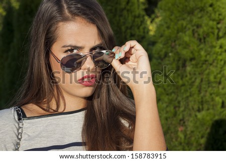 Beautiful model with glasses in the park
