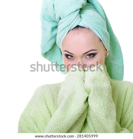 beautiful model with healthy skin face in bathrobe and towel, over white background - stock photo