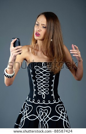 Beautiful model with mobile phone - stock photo