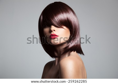 Beautiful model with perfect long glossy brown hair. Close-up portrait. - stock photo