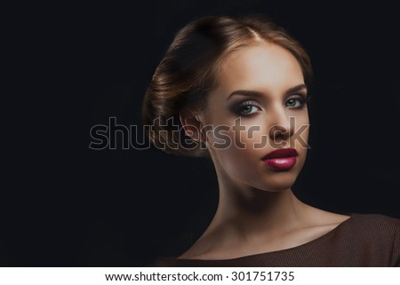 beautiful model with retro makeup and hair style - stock photo