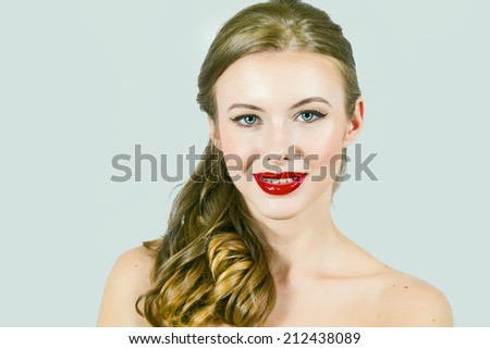 Beautiful Model With Strawberry Lips and Long Blond Hair - stock photo