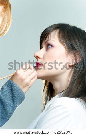 Beautiful model woman is getting prepared for photo shoot - stock photo