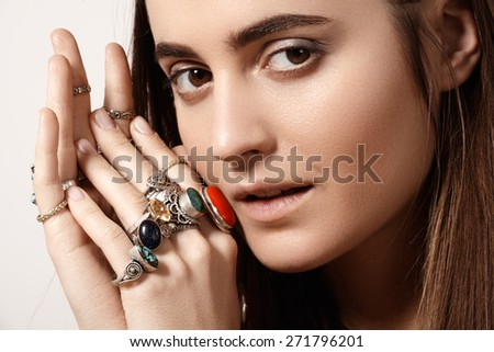 Beautiful model woman with clean skin, perfect hair, natural fashion makeup. Luxurious style with awesome chic jewellery, vintage ring. Romantic boho accessory - stock photo