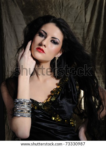 Beautiful model woman with long black healthy hair and bright make-up