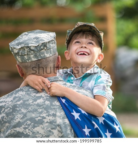 Beautiful modern american family. Father wearing military uniform hugs his son - stock photo