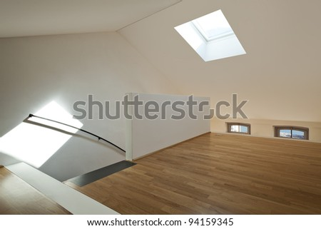 beautiful modern apartment, view of room under the roof - stock photo