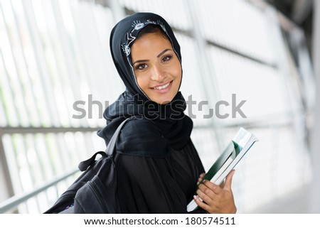 beautiful modern arabian university student with books - stock photo