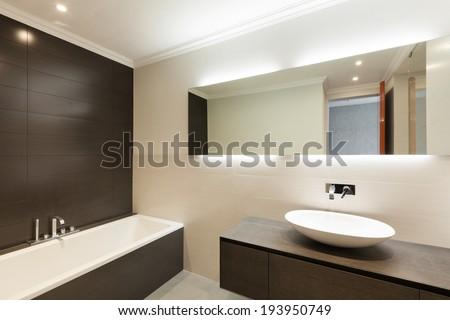 beautiful modern bathroom, ceramic basin and mirror - stock photo