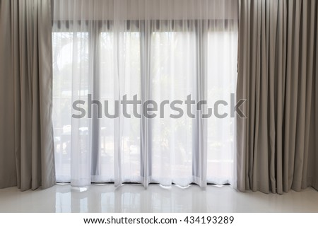 Beautiful modern grey and white curtains in living room - stock photo