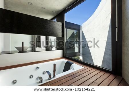 beautiful modern house in cement, interior, bathroom - stock photo