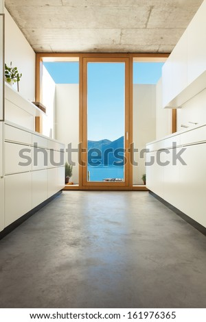 beautiful modern house in cement, interiors, white kitchen - stock photo