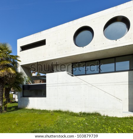 beautiful modern house in cement, outdoor, facade - stock photo