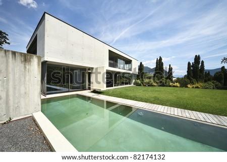 beautiful modern house outdoors, pool view - stock photo