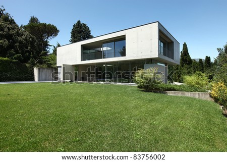 beautiful modern house outdoors, view from garden - stock photo