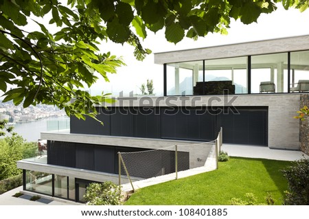 beautiful modern house, view from garden - stock photo