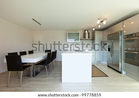 beautiful modern house, view of kitchen with dining table