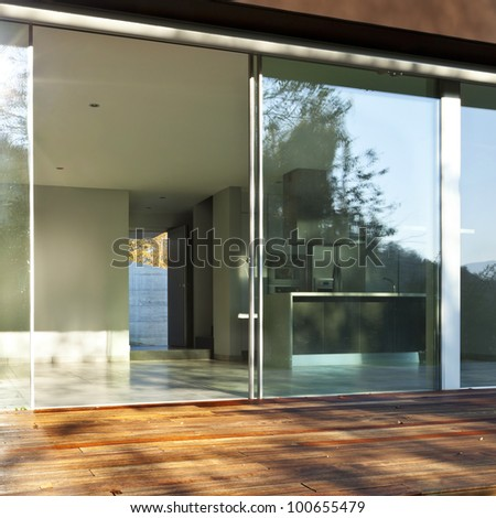 beautiful modern house, view of the interior from the patio - stock photo