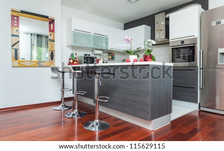 Beautiful modern kitchen in designer house - stock photo