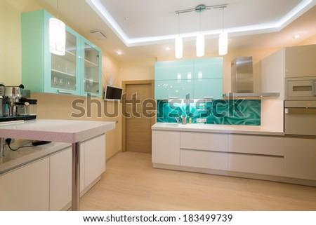Beautiful modern kitchen with TV and coffee machine. - stock photo
