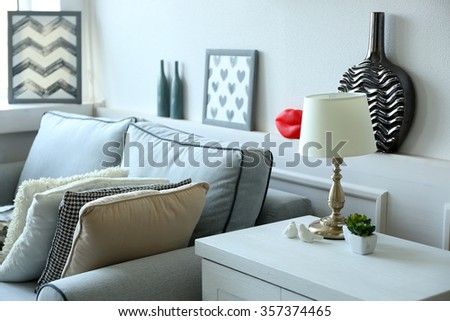 Beautiful modern living room with grey sofa - stock photo
