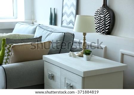 Beautiful modern living room with grey sofa - stock photo