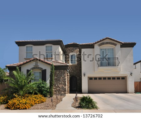 Beautiful modern new home with blue sky - stock photo