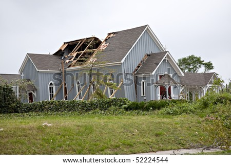 Beautiful modern wooden church after tornado damage - stock photo