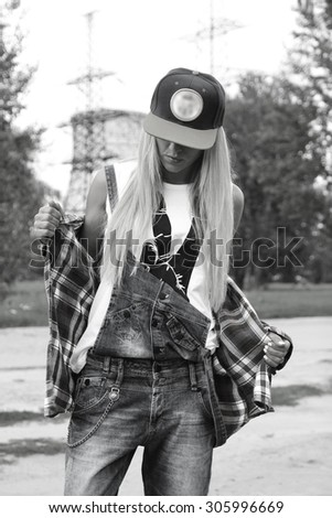Beautiful modern young woman in a trendy clothes black and white. Youth style. Fashion shot. - stock photo