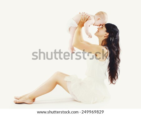 Beautiful mom with her cute baby having fun together  - stock photo