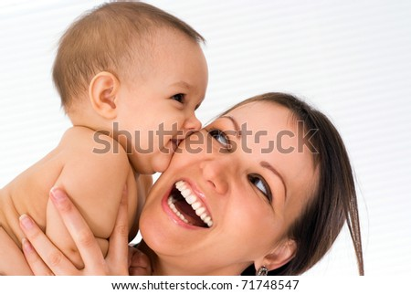 beautiful mom with newborn - stock photo