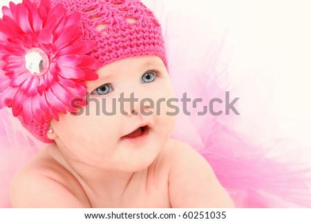 Beautiful 4 month old american baby girl in flower hat and tutu over white background. - stock photo