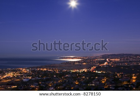 Beautiful Moon Set over Dana point taken from San Clemente. - stock photo
