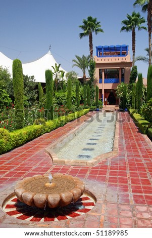 Beautiful Moorish garden on the grounds of a luxury hotel in Marrakech, Morocco - stock photo