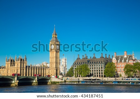 Beautiful morning by Thames river in London with Big Ben, Westminster and red buses. - stock photo