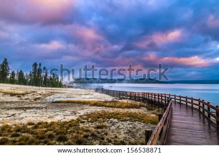 Beautiful Morning in West Thumb Geyser Basin with Yellowstone Lake in the bacground - stock photo
