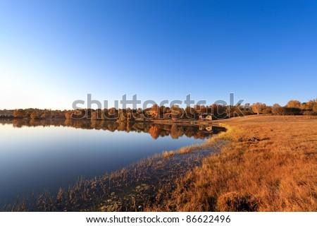 beautiful morning landscape of the lake at autumn - stock photo