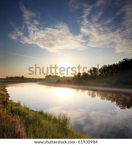 beautiful morning landscape with sunrise over river - stock photo