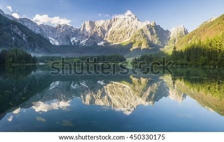 beautiful morning on the alpine lake in Italian Alps - stock photo