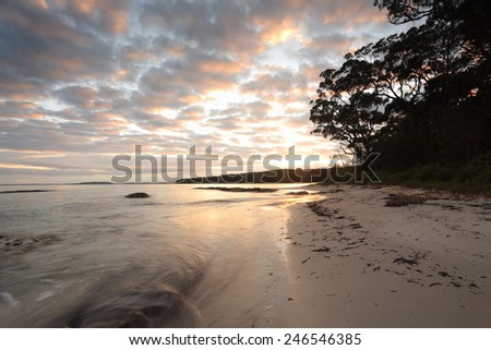 Beautiful morning with pretty clouds and a high tide at Scottish Rocks Jervis Bay Australia - stock photo