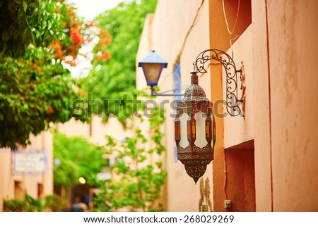 Beautiful Moroccan lantern on a building in Marrakech - stock photo