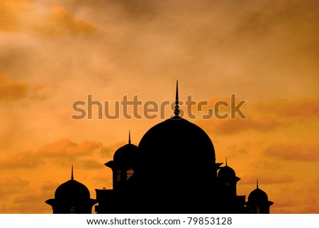 beautiful mosque silhouette during sunset - stock photo