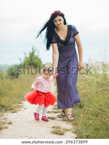 Beautiful Mother And Baby outdoors - stock photo