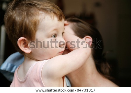 Beautiful mother and cute little boy cuddling and playing together - stock photo